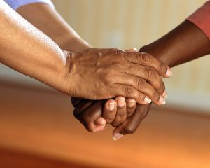 two people clasp hands