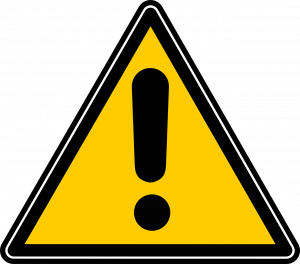 Yellow triangular warning sign with a black exclamation point