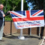 East Sussex County council chairman Cllr Colin Belsey, with chief operating officer Kevin Foster, raises the flag at County Hall to mark Armed Forces Day