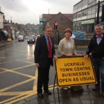 Cllr Chris Dowling, East Sussex County Council member for Ridgewood and Framfield, Cllr Claire Dowling, county council member for Uckfield and member of the project board and Uckfield town mayor Ian Smith, with one of the new signs reinforcing the message that Uckfield town centre is open as normal