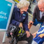Trading Standards illegal tobacco events - Lee Ede, from East Sussex Trading Standards, with sniffer dog Phoebe and visitors to the event in St Leonards