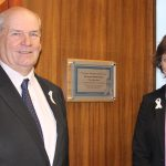 Cllr Keith Glazier, East Sussex County Council leader, and Becky Shaw, county council chief executive, unveil the White Ribbon plaque at County Hall