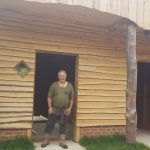 Carl Folkes by the stable he built at Little Gate Farm, Beckley