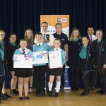 Josh Hayler, apprentice (centre, black shirt), with Hannah Hayler, Rob Muggridge and Steve Baldry from Marshall Tufflex, winner of the SELEP best small to medium enterprise in the south east region, with students from Hastings-based ARK Helenswood Academy and ARK Blacklands Primary Academy