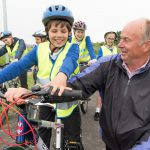 Cllr Nick Bennett and child from Tollgate Junior School, Eastbourne, at launch of Horsey Way