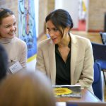 The Duchess of Sussex with UK Youth Cabinet member Indya Wardle and a copy of the Top Ten Tips mental health guide for schools during the visit to Peacehaven